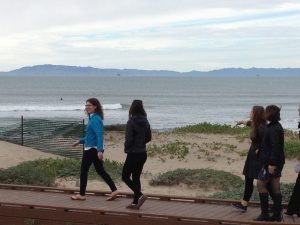People walking near dunes at Surfers Point