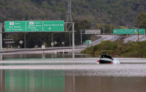 Car stuck on flooded highway