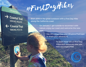 Photo of child touching a coastal trail sign.